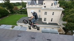 Chris Northover rides his Oset electric trials bike in, under and on the old Russian consulate.